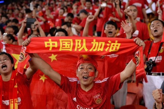 BRISBANE, AUSTRALIA - JANUARY 14: A Chinese fan celebrates his teams victory after the 2015 Asian Cup match between China PR and Uzbekistan at Suncorp Stadium on January 14, 2015 in Brisbane, Australia. (Photo by Bradley Kanaris/Getty Images)